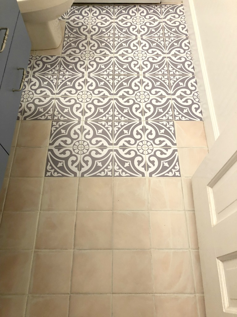 bathroom floor with tile stickers