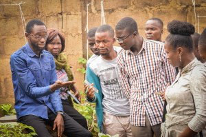 Mr. Samson introduces the participants to hydroponics farming in his mini-farm