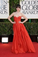 Up-do, red dress, and pearls Zooey Deschanel proves prom-queen chic works on the red carpet.