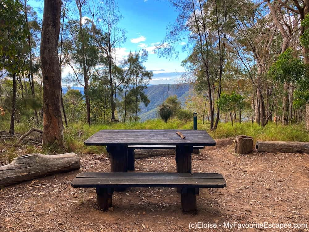 Picnic table with a lookout in the background at Thilba Thalba campsite on the Gheerulla Valley Circuit in Mapleton National Park
