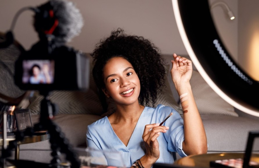 Girl demonstrating makeup infront of camera - How to make money online as a teenager with youtube -My Financial Hill