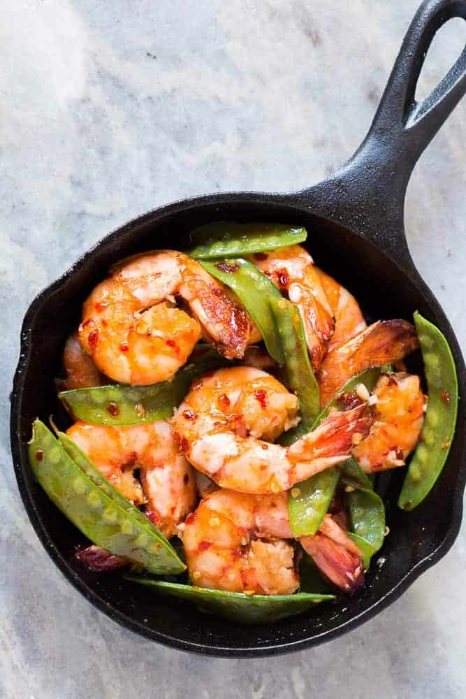 Looking for meals that take under 15 minutes? This is it - 5 ingredient honey garlic chilli jumbo tiger prawns! All the asian flavours you love in this one easy recipe! You can use shrimp, prawns or scampi and add whatever veggie you like - broccoli, bok choy, beans or even spinach! Soy free, gluten free, probably Whole30, Paleo and nut free!