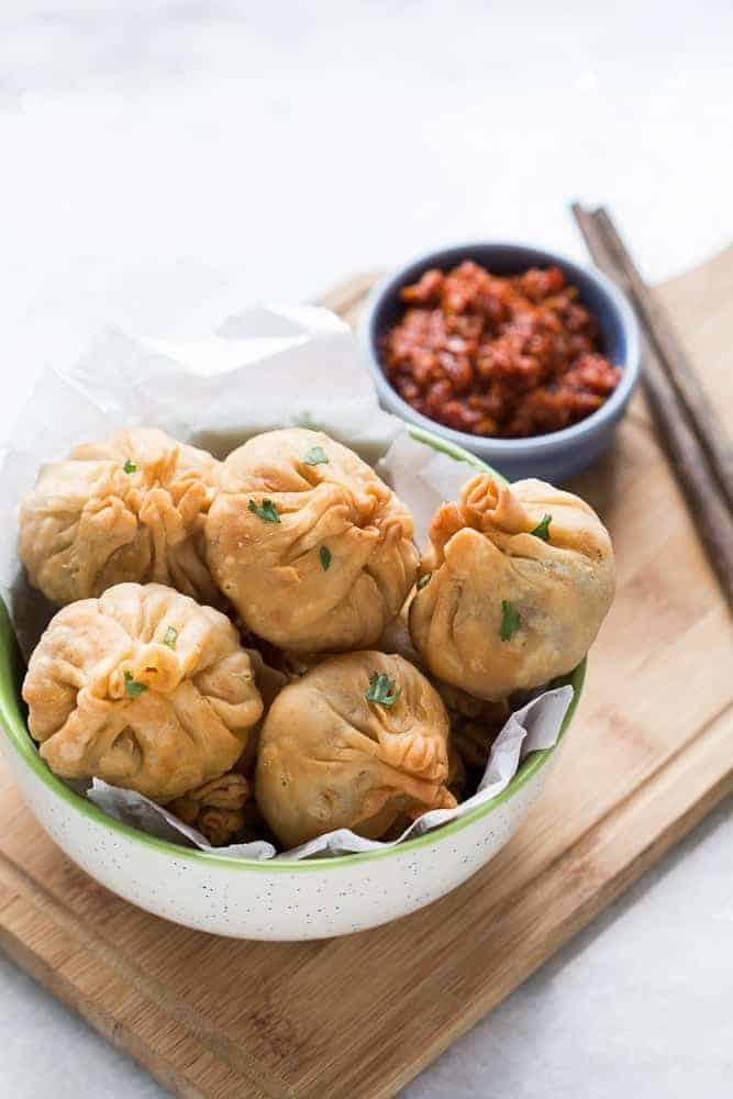 Love samosas? These vegetarian chinese potli samosa wontons are going to blow you over! I used a lo mein noodle filling but you can just as easily use shrimp, cream cheese, even chocolate to make these wontons at home. Also includes recipe for homemade samosa wrappers!