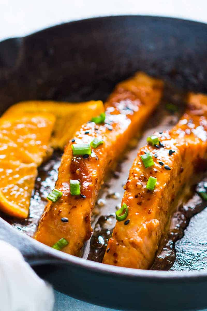 Pan seared orange mustard salmon - easy, healthy, 15 minute dinner with a sticky marinade. Clean eating ingredients, serve with pasta, cauliflower rice or asparagus