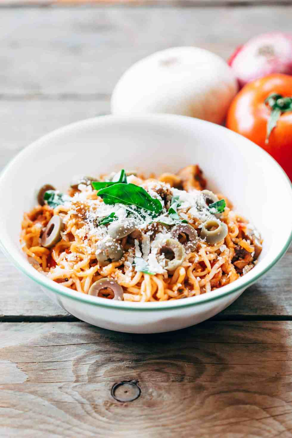 Italian Maggi recipe has all the flavours of your favourite pasta and pizza with mushrooms, marinara sauce, olives, basil and lots of cheese. Here are four amazing maggi recipes in one post that you must try - Italian Maggi, Cheese and Egg Maggi, Chinese Maggi and Spicy Masala Maggi for all your Maggi lovers!