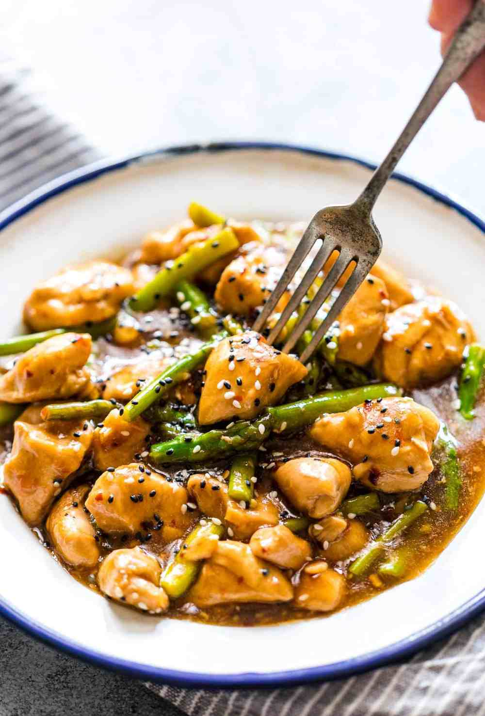 Easy lemon ginger chicken asparagus stir fry is a quick, 30 minute asian recipe that's sure to be a hit with the family. It's low carb and can gluten free too so you can enjoy it guilt-free!