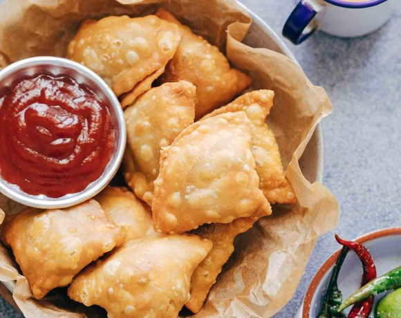 This is definitely the best Indian punjabi samosa you'll every make at home! I'm arming you with step by step directions and a recipe video for you to follow. So you can learn how to make the samosa dough, the aloo stuffing and how to easily wrap them.