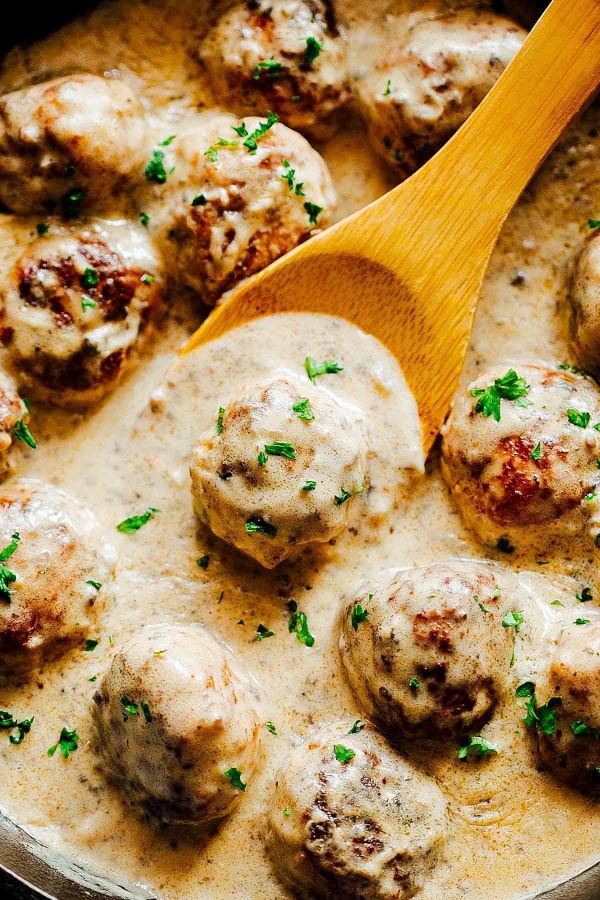 Closeup of creamy chicken meatballs in mushroom sauce