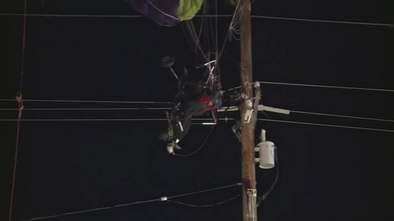 Paraglider rescued after crash into power lines