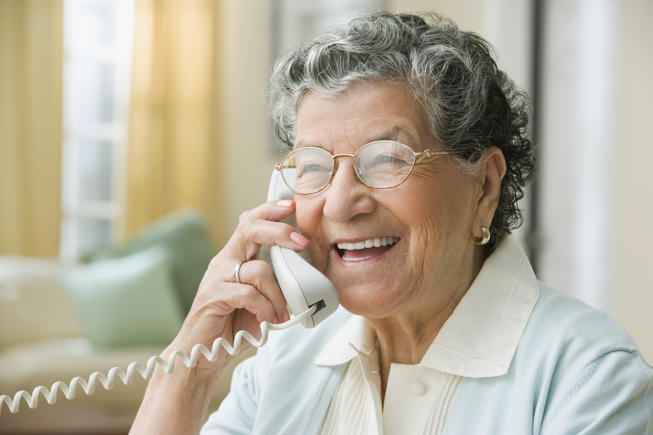 Senior woman talks on the phone. (Getty Images)