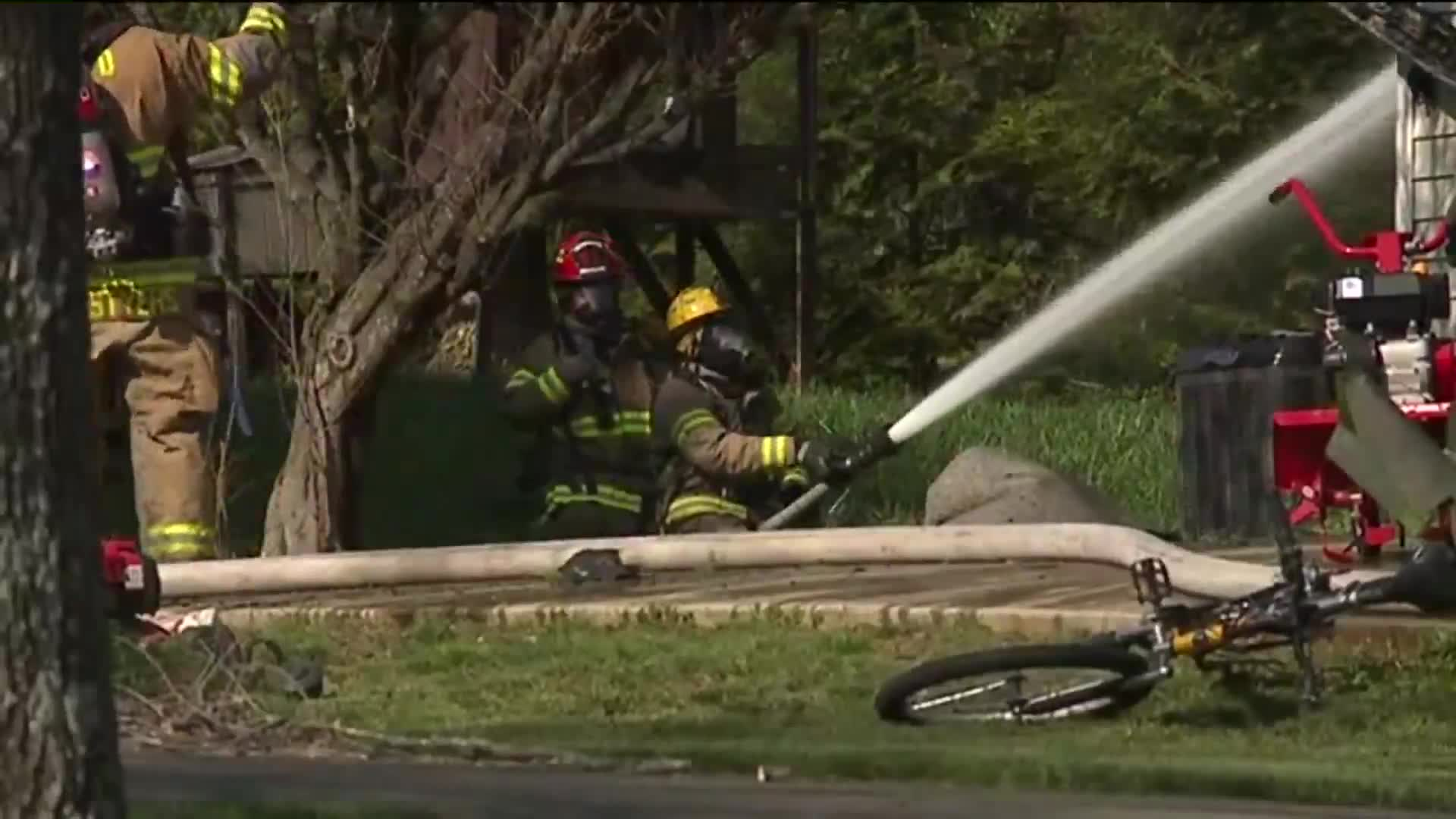 Firefighters putting out house fire in Forsyth County
