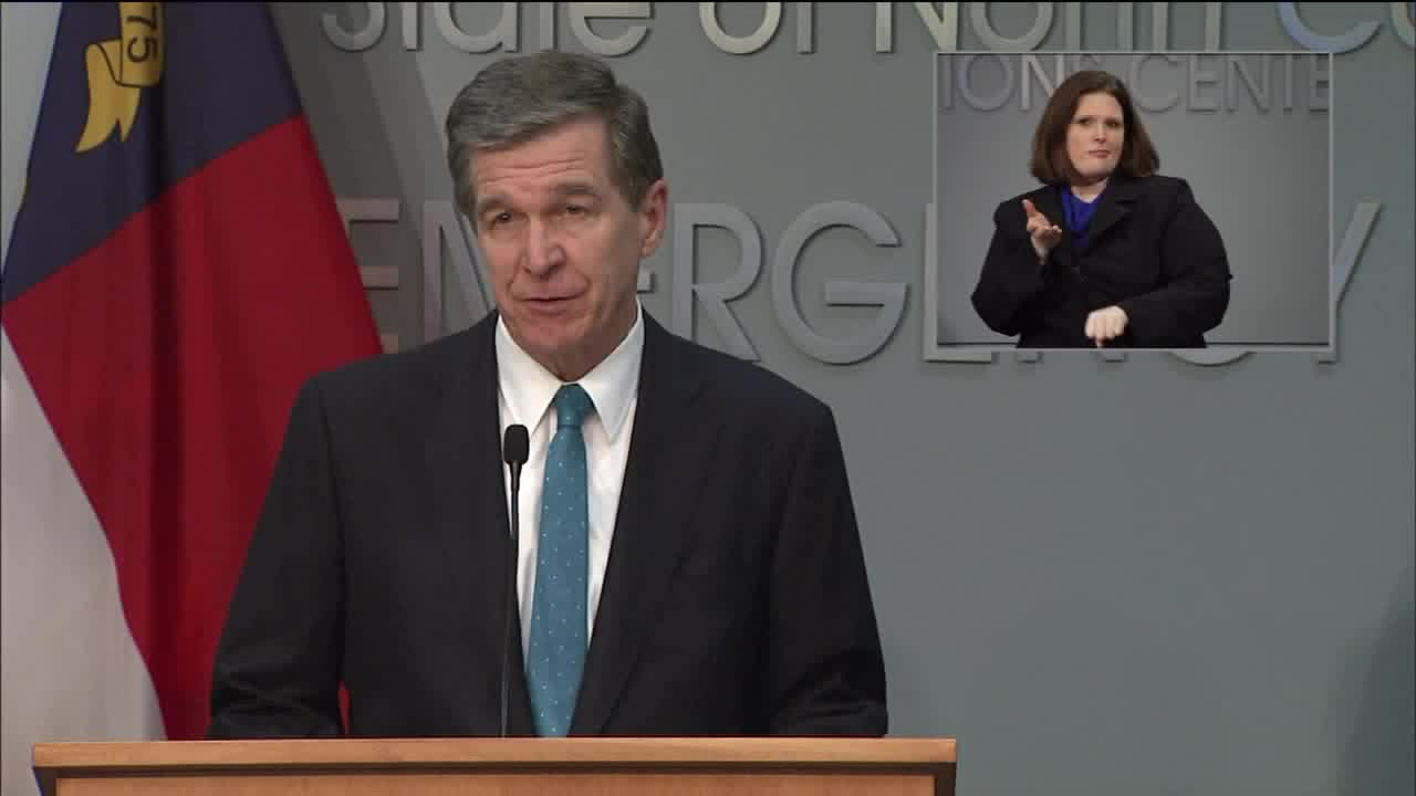 Gov. Roy Cooper signs executive order limiting number of shoppers in stores