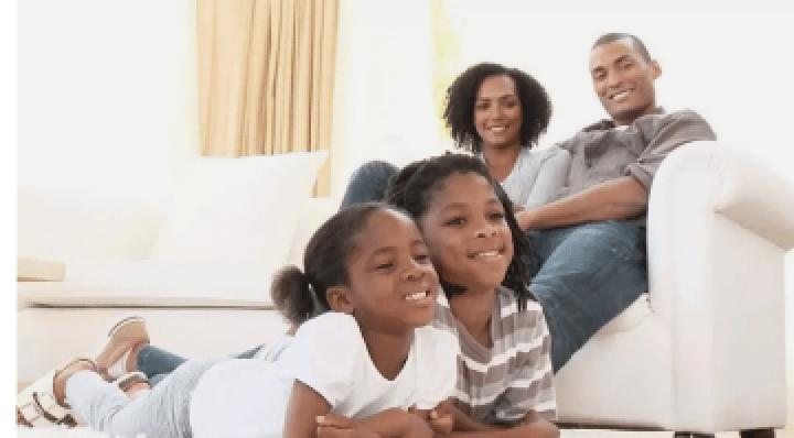 Family enjoying programs on GOtv