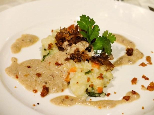 Duck Confit on Bubur Menado with Foie Gras Sauce