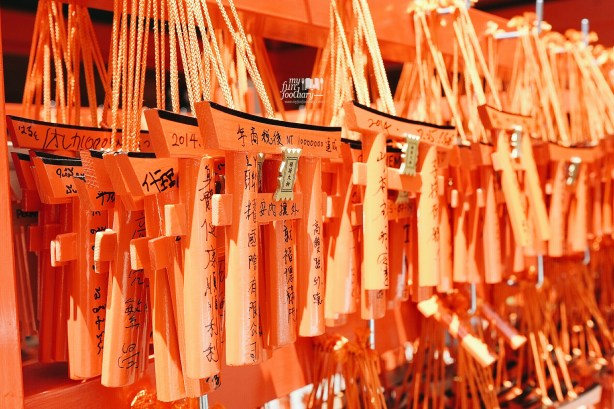Stacks of miniature torii gates that were donated by visitors with smaller budgets at Fushimi Inari Taisha Kyoto by Myfunfoodiary