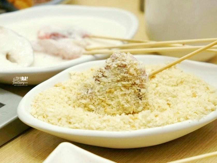 Dip into bread crumbs at Kushiya Monogatari by Myfunfoodiary