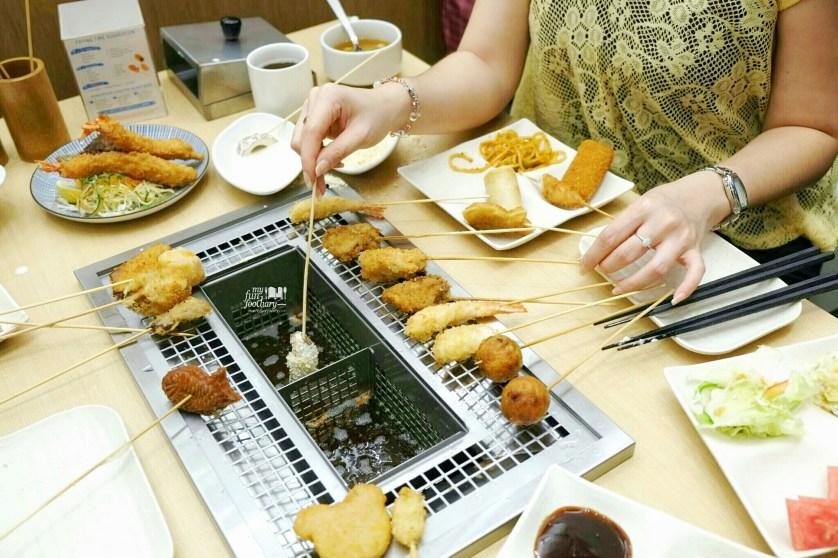 Mullie is ready to cook at Kushiya Monogatari by Myfunfoodiary