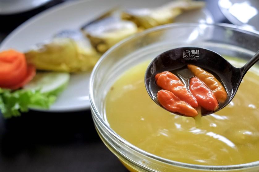 Kuah Ikan Bandeng Kuning at Puang Oca Restaurant by Myfunfoodiary