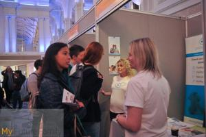Visitors talking to exhibitors