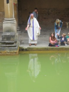 A priest blessing visitors to the Roman Baths