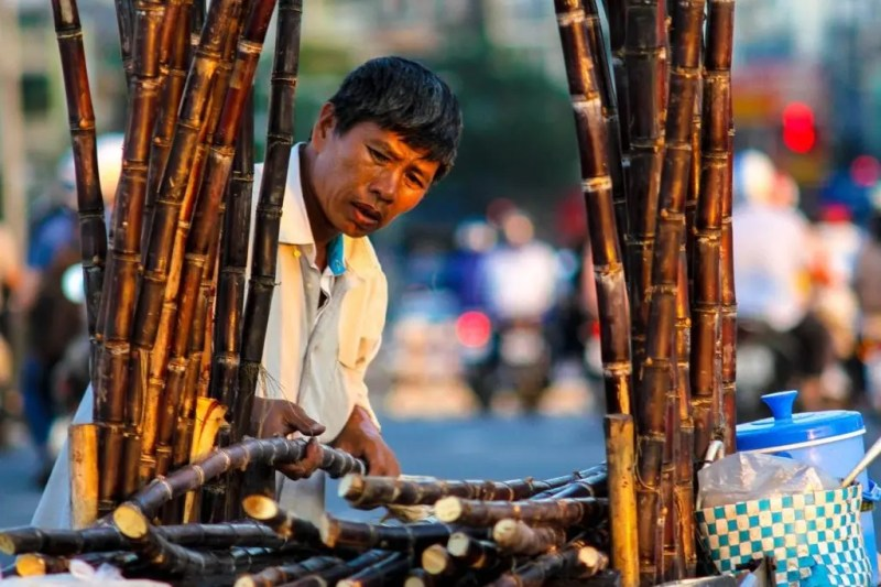 Street vendor selling sugar cane juice