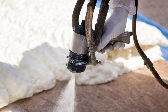 Technician,Spraying,Foam,Insulation,Using,Plural,Component,Spray,Gun