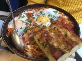 Baked eggs with fennel sausage