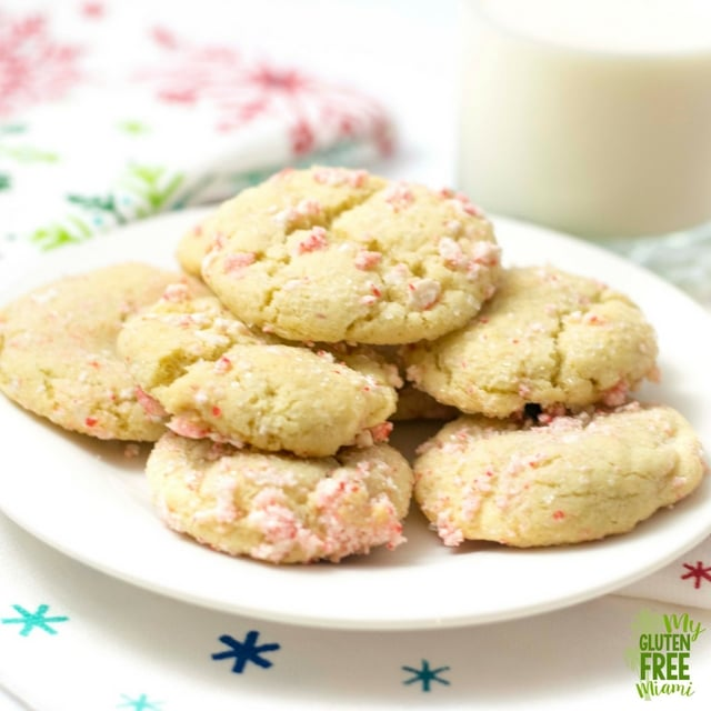 Gluten Free Peppermint Snickerdoodles are soft on the inside, crunchy on the outside & full of peppermint flavor! Crushed candy canes add the perfect touch.
