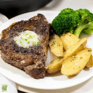 Ginger Garlic Compound Butter over New York Strip Steak