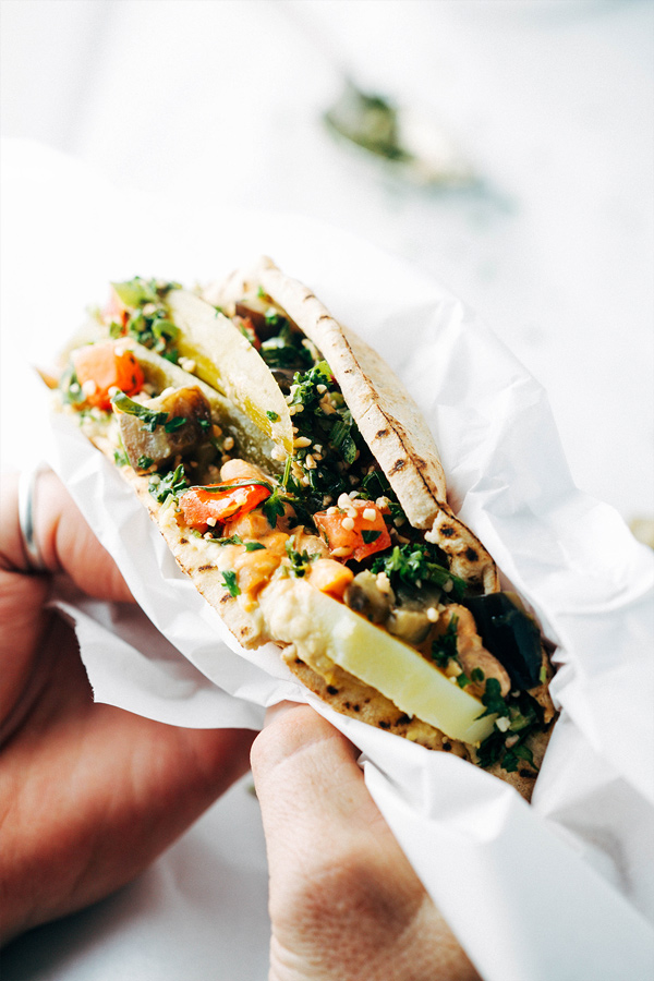 This vegan sabich sandwich is a twist on the traditional Israeli sandwich using white beans instead of egg.