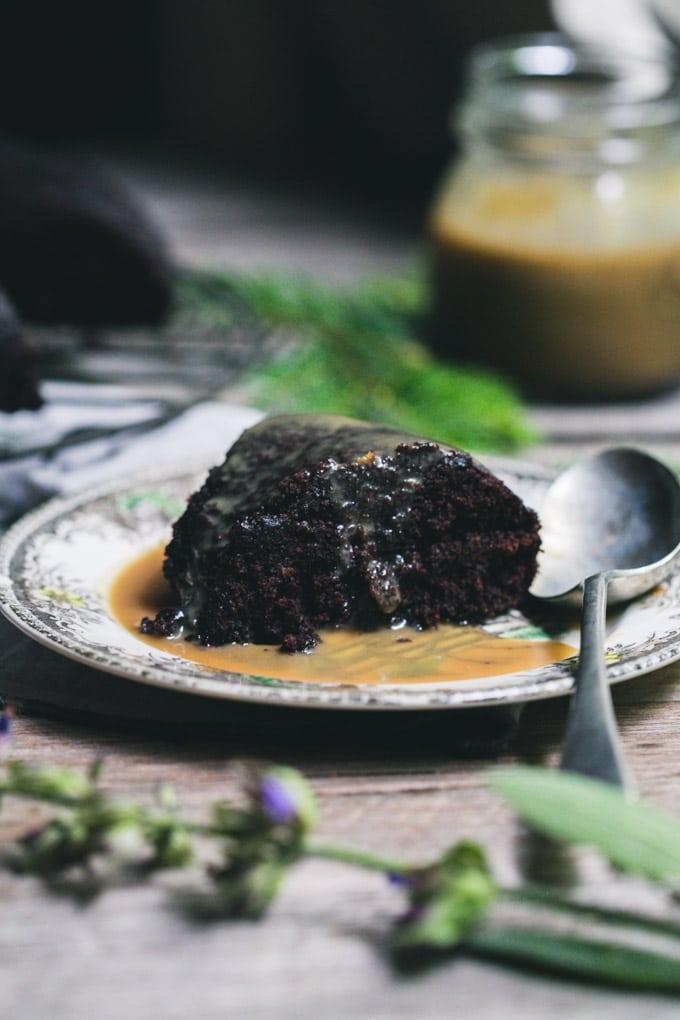 A slice of chocolate bundt cake with sauce