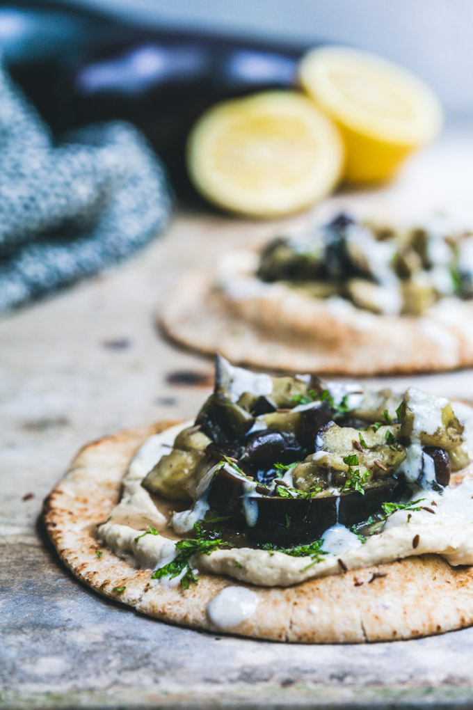 Close up of cooked eggplant pita breads on a board