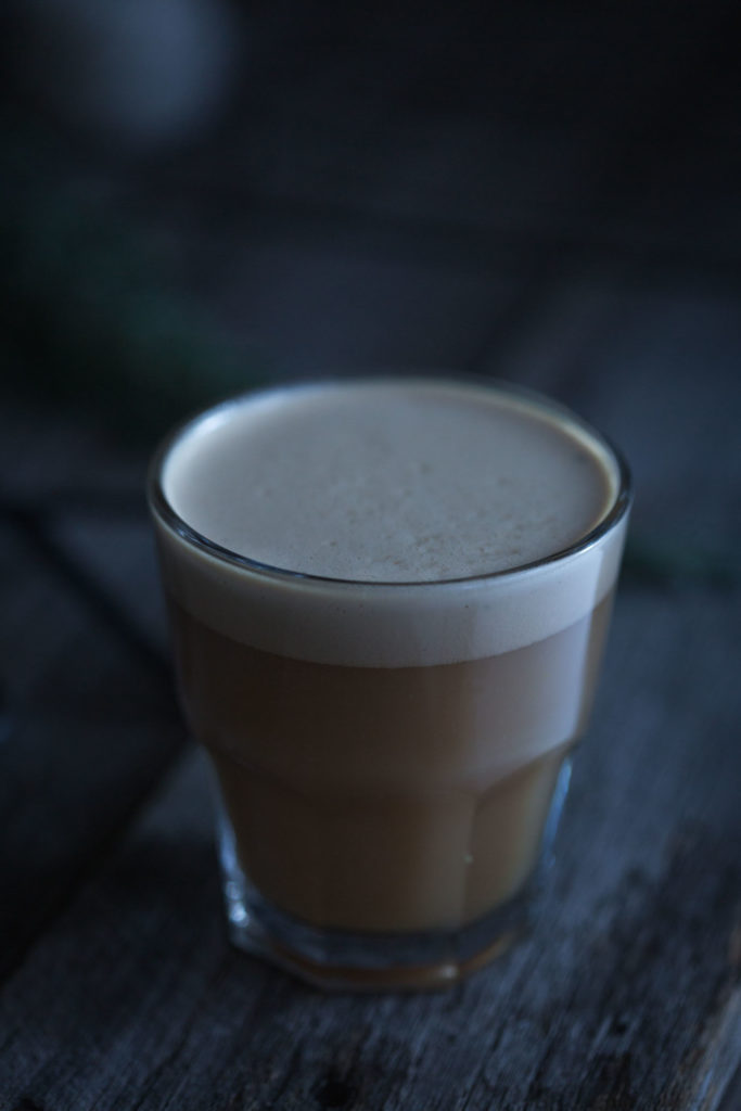 A close up image of milk tea drink in a glass
