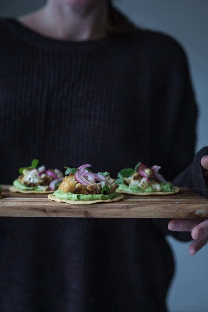 With coffee and smoky Mexican spices massaged in to a whole roasted cauliflower, these Black Rub Cauliflower Tostaditas are a vegan flavour fiesta.