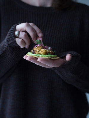 A woman holding a taco