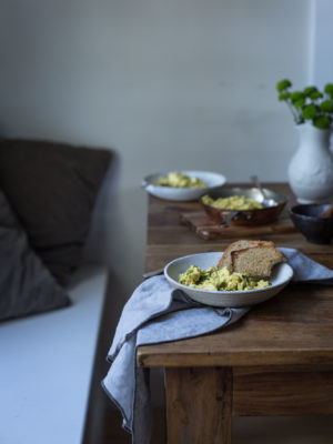 A plate of scrambled tofu and toast on a breakfast table