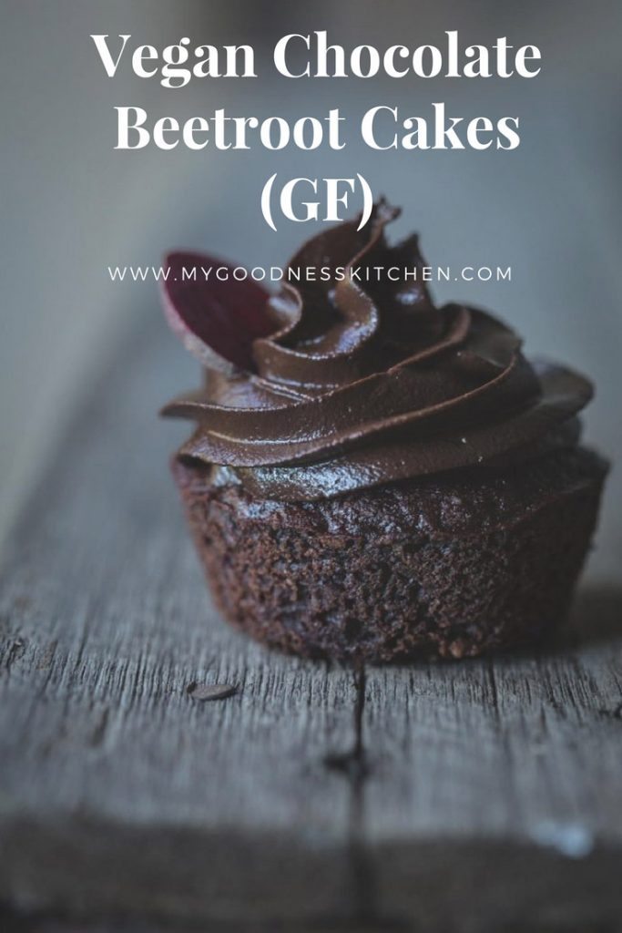 A vegan chocolate cupcake with frosting