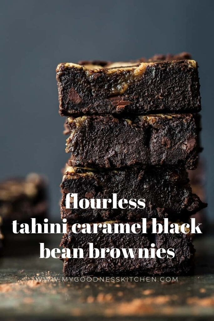 Front on image of a stack of 4 black bean brownies slices stacked on a rustic board. Title text overlay in white.