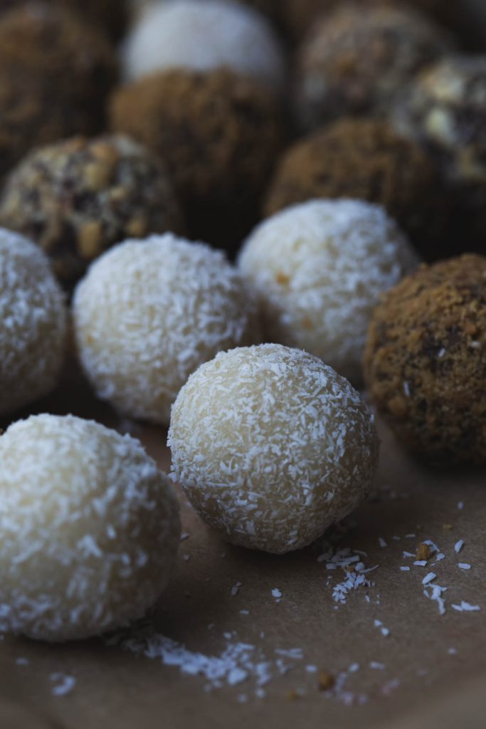 close up image of vegan white chocolate coconut truffle