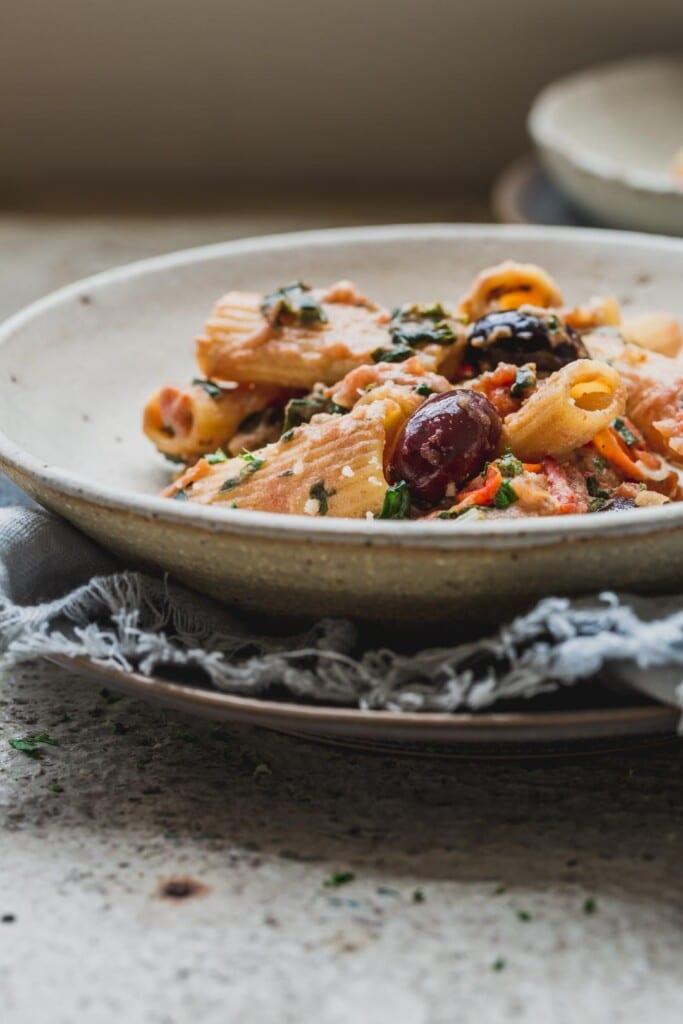 A close up image of a bowl of 1-pot creamy tomato vegan pasta