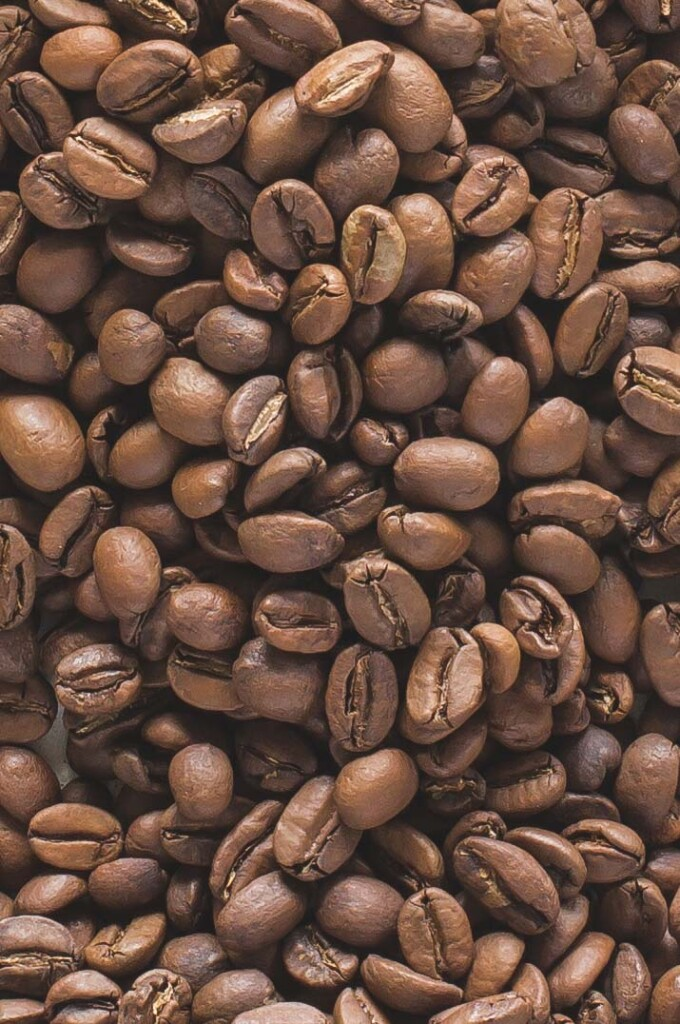 Close up image of coffee beans covering the entire image frame