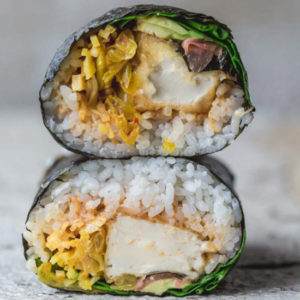 A close up of a sushi burrito