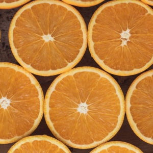 Oranges cut in half in a pattern