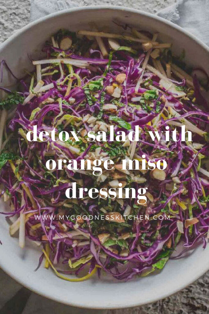 close-up flat-lay image of a large bowl of detox salad with orange miso dressing with title text overlay