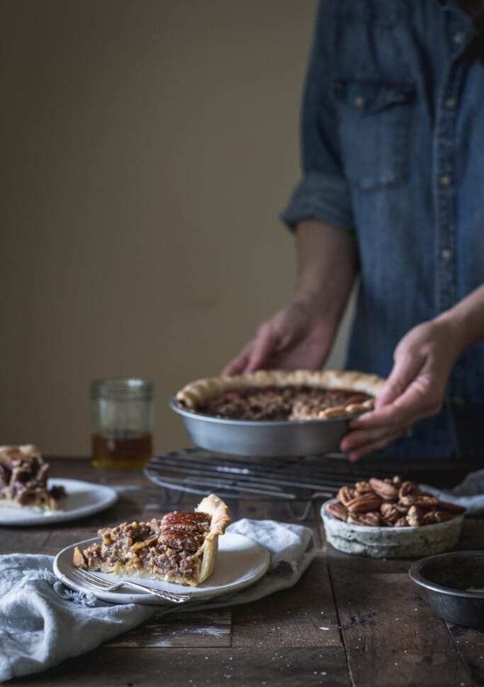 Woman serving vegan pecan pie