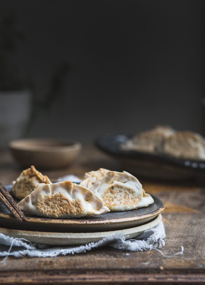 close up image of pan fried mushroom and kimchi dumplings