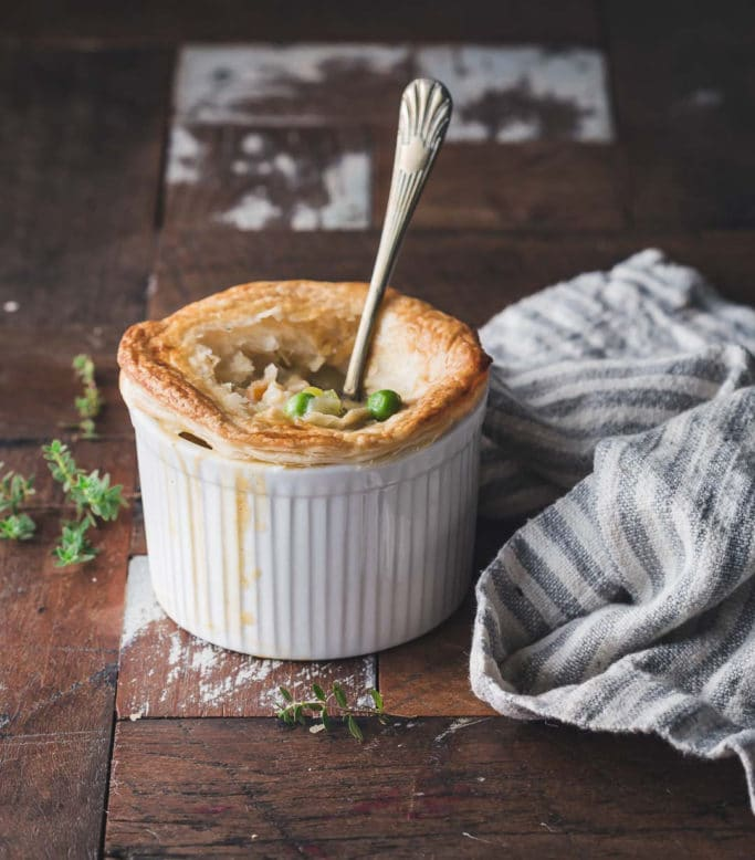 A vegan chicken-style pot pie in a white ramekin