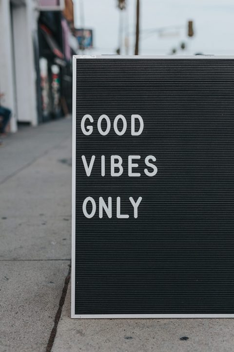 "A sign on the side of the street saying ""Good Vibes Only\"""