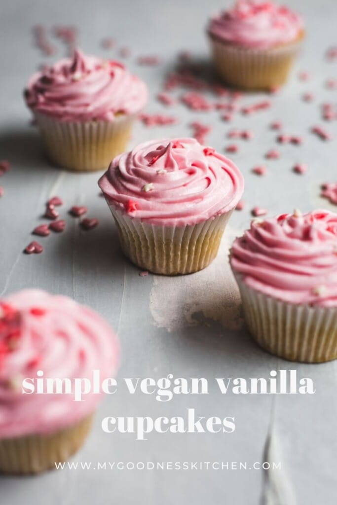 Close up image of vegan vanilla cupcakes with pink buttercream frosting with text overlay