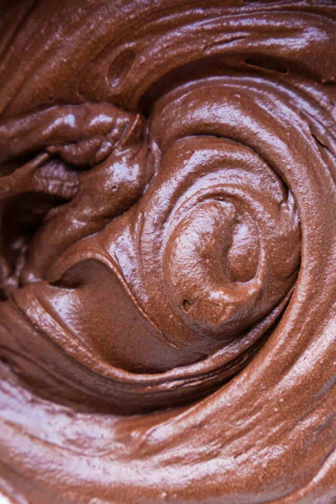 close-up, full frame image of a vegan chocolate frosting swirl